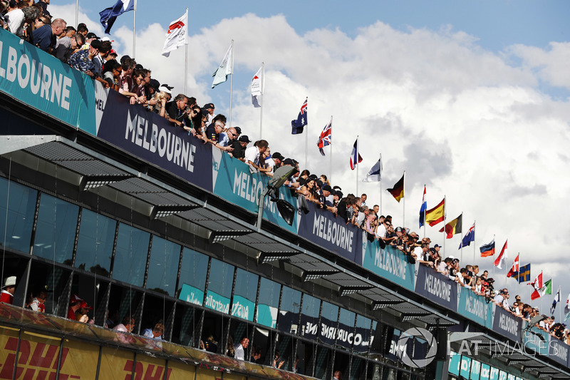 Fans watch action from above the pit lane