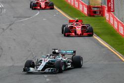 Lewis Hamilton, Mercedes AMG F1 W09, leadsSebastian Vettel, Ferrari SF71H, and Kimi Raikkonen, Ferrari SF71H