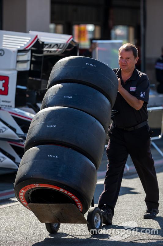 Mechanic with Firestone tires
