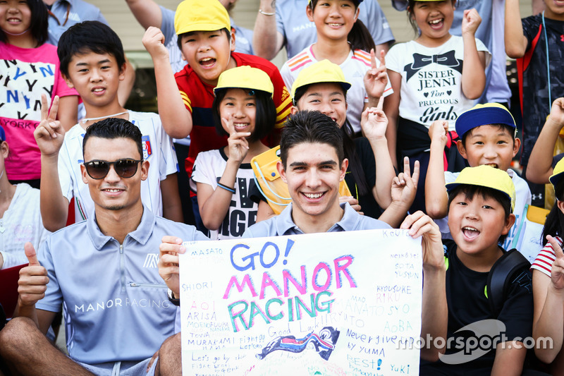 (L to R): Pascal Wehrlein, Manor Racing and team mate Esteban Ocon, Manor Racing with young fans