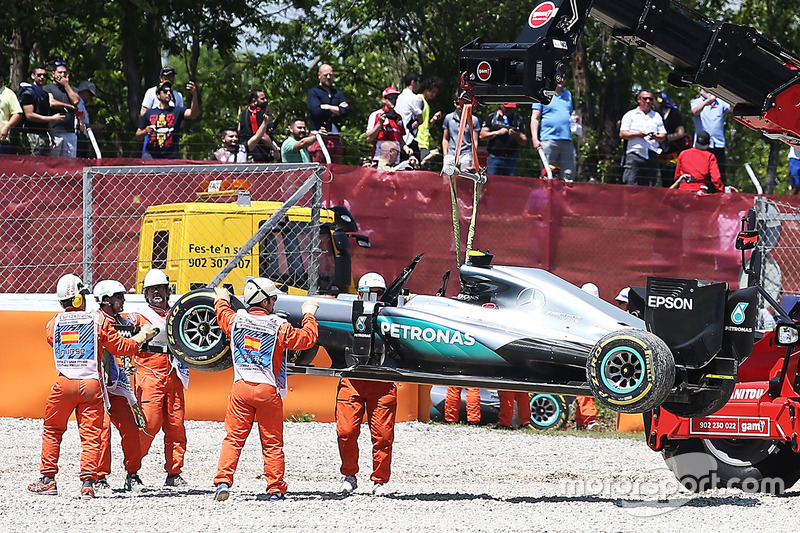 The Mercedes AMG F1 W07 Hybrid of race retiree Nico Rosberg, Mercedes AMG F1 is craned away from the gravel trap at the start of the race