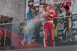 Podium: third place John Bowe celebrates with champagne