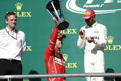 Second place Sebastian Vettel, Ferrari, lifts his trophy on the podium