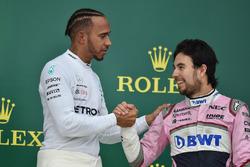 Lewis Hamilton, Mercedes-AMG F1 and Sergio Perez, Force India celebrate on the podium