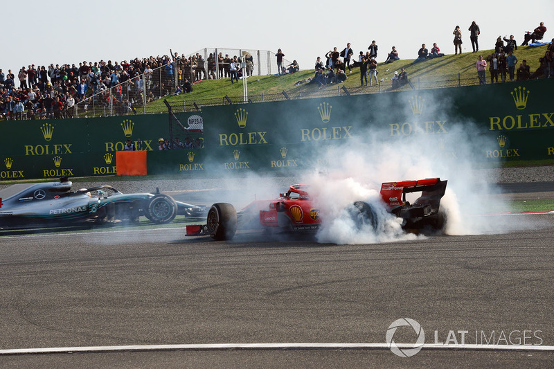 Sebastian Vettel, Ferrari SF71H spins after clashing with Max Verstappen, Red Bull Racing RB14 as Lewis Hamilton, Mercedes-AMG F1 W09 EQ Power+ passes