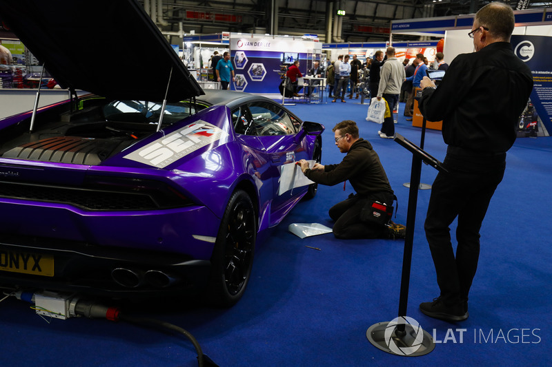 Final preparations are applied to a Lamborghini