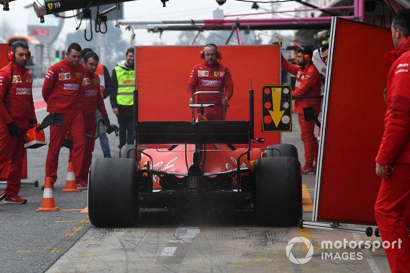 Sebastian Vettel, Ferrari SF90 and Ferrari mechanics with screens
