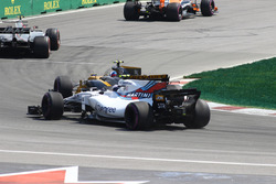 Lance Stroll, Williams FW40 and Jolyon Palmer, Renault Sport F1 Team RS17