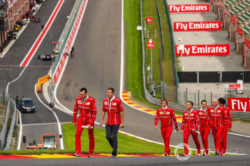 Sebastian Vettel, Ferrari walks the track, Adami, Ferrari Race Engineer, Jock Clear, Ferrari Chief Engineer, trainer Antti Kontsas, the team