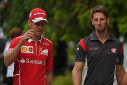 Sebastian Vettel, Ferrari and Romain Grosjean, Haas F1