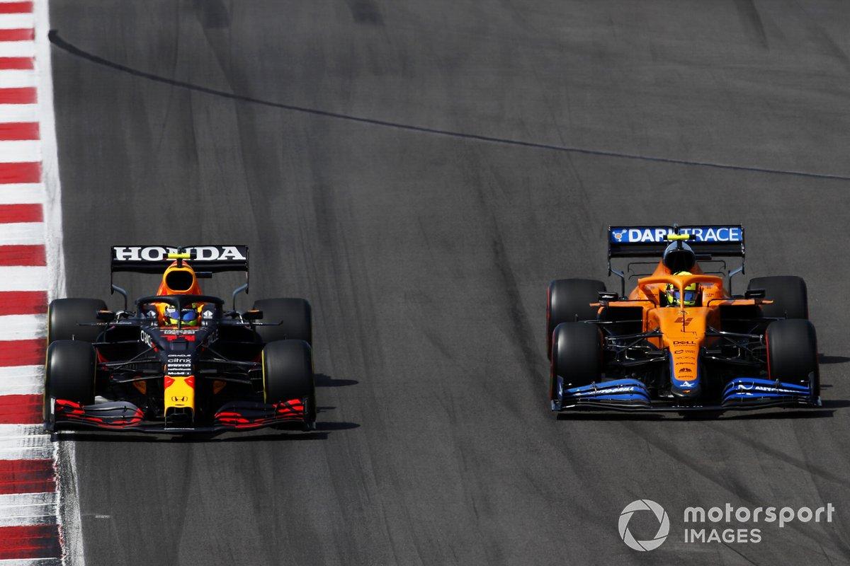 Sergio Perez, Red Bull Racing RB16B, battles with Lando Norris, McLaren MCL35M
