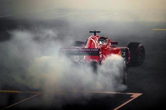 Sebastian Vettel, Ferrari SF71H, performs donuts after the race