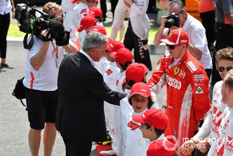 Чейз Кері, керівник Формули 1, та Кімі Райкконен, Ferrari