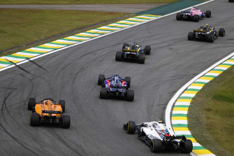 Sergey Sirotkin, Williams FW41, chases Fernando Alonso, McLaren MCL33, and Brendon Hartley, Toro Rosso STR13.