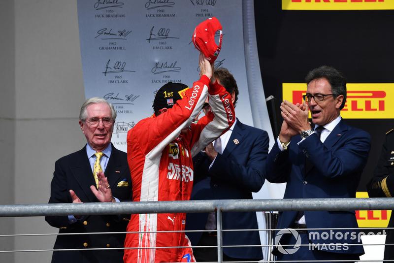 Race winner Kimi Raikkonen, Ferrari celebrates on the podium