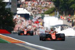 Stoffel Vandoorne, McLaren MCL32, leads Fernando Alonso, McLaren MCL32
