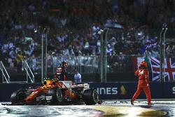 Kimi Raikkonen, Ferrari SF70H, Max Verstappen, Red Bull Racing RB13, climb out of their damaged cars