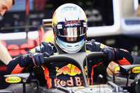 Daniel Ricciardo, Red Bull Racing RB13, climbs into his cockpit, fitted, a halo