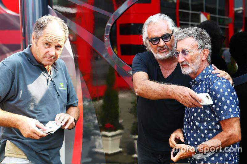 (L to R): Gerhard Berger, with Flavio Briatore, and Eddie Jordan