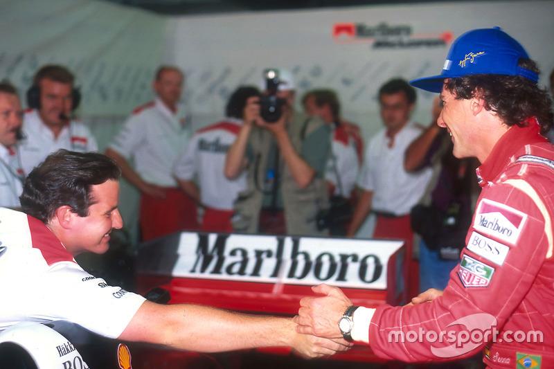 Ayrton Senna , McLaren is congratulated by team collegues