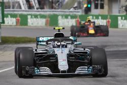 Valtteri Bottas, Mercedes AMG F1 W09, leads Max Verstappen, Red Bull Racing RB14
