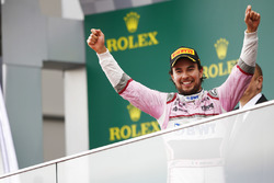 Sergio Perez, Force India, celebrates on the podium after the race