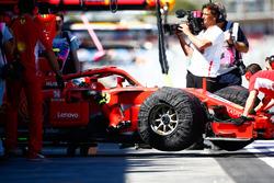 Kimi Raikkonen, Ferrari SF71H, is returned to the garage