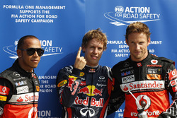 Polesitter  Sebastian Vettel, Red Bull Racing, second place Lewis Hamilton, McLaren and third place Jenson Button, McLaren
