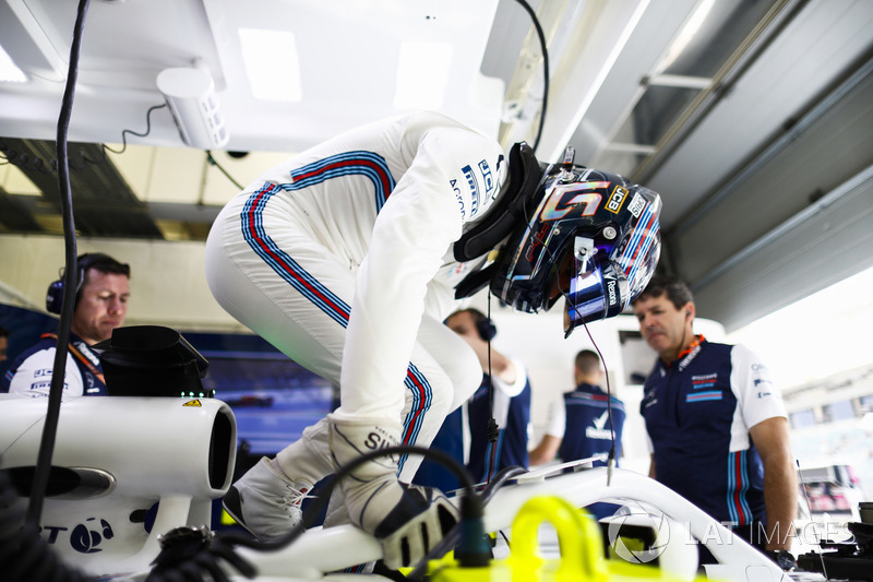 Lance Stroll, Williams Racing, climbs into his car