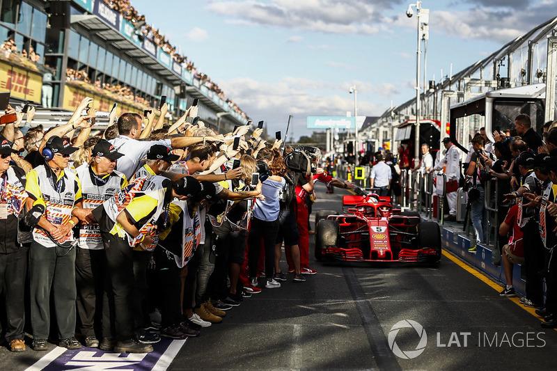 Race winner Sebastian Vettel, Ferrari SF71H celebrates with Maurizio Arrivabene, Ferrari Team Principal in parc ferme