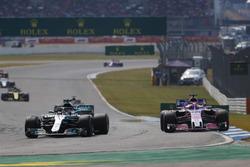 Lewis Hamilton, Mercedes AMG F1 W09, passes Sergio Perez, Force India VJM11