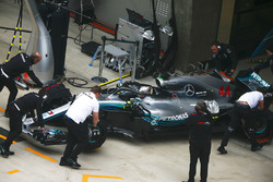 Lewis Hamilton, Mercedes AMG F1 W09, is returned to the garage