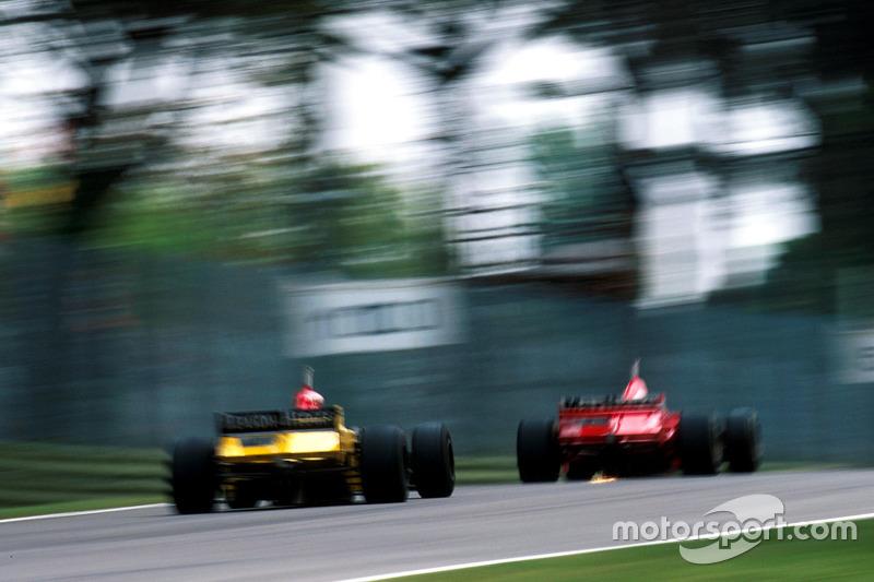 Giancarlo Fisichella, Benetton B198 and Eddie Irvine, Ferrari F310BG