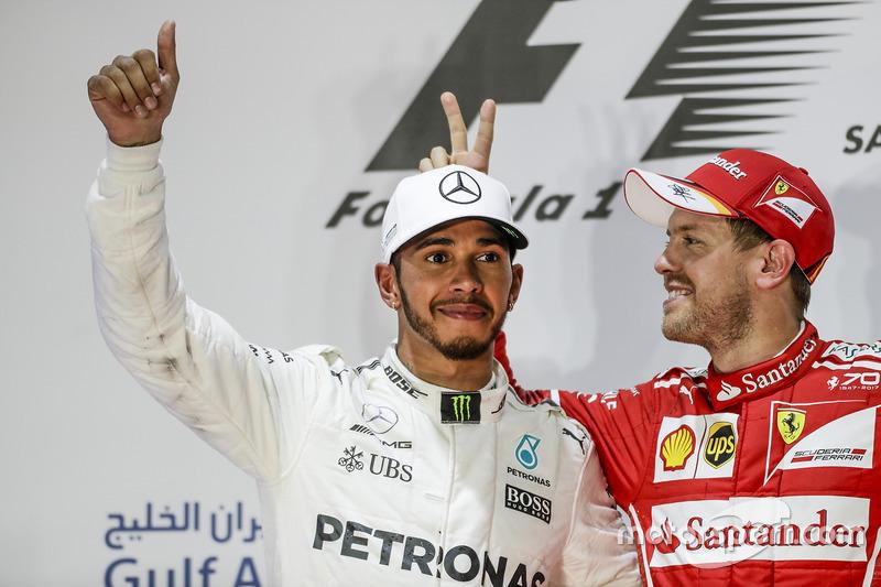 5. Lewis Hamilton, Mercedes AMG, second place, Sebastian Vettel, Ferrari, race winner, on the podium