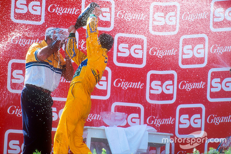 Podium: race winner Michael Schumacher, Benetton, Flavio Briatore