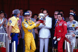 Podium: race winner Ayrton Senna, Team Lotus, third place Michele Alboreto, Ferrari, second place Nelson Piquet, Williams while Lotus boss Peter Warr stands next to Senna to collect the constructors prize