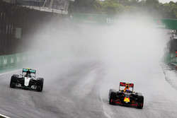 (L to R): Nico Rosberg, Mercedes AMG F1 W07 Hybrid and Max Verstappen, Red Bull Racing RB12 battle f