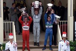 Podium: Race winner David Coulthard, McLaren, second place Rubens Barrichello, Ferrari, third place Giancarlo Fisichella, Benetton