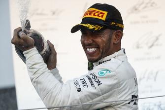 Race winner Lewis Hamilton, Mercedes AMG F1, sprays Champagne on the podium