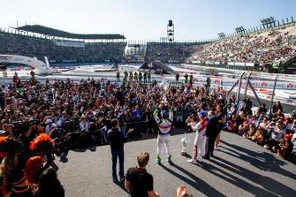 Winner Benito Guerra celebrates on the podium with runner up Loic Duval and ROC Skills Challenge winner Sebastian Vettel