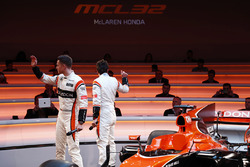Race drivers Stoffel Vandoorne and Fernando Alonso acknowledge guests at the launch of the McLaren MCL32