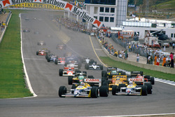 Nelson Piquet, Williams FW11B Honda and teammate Nigel Mansell, Williams FW11B Honda, lead Ayrton Se