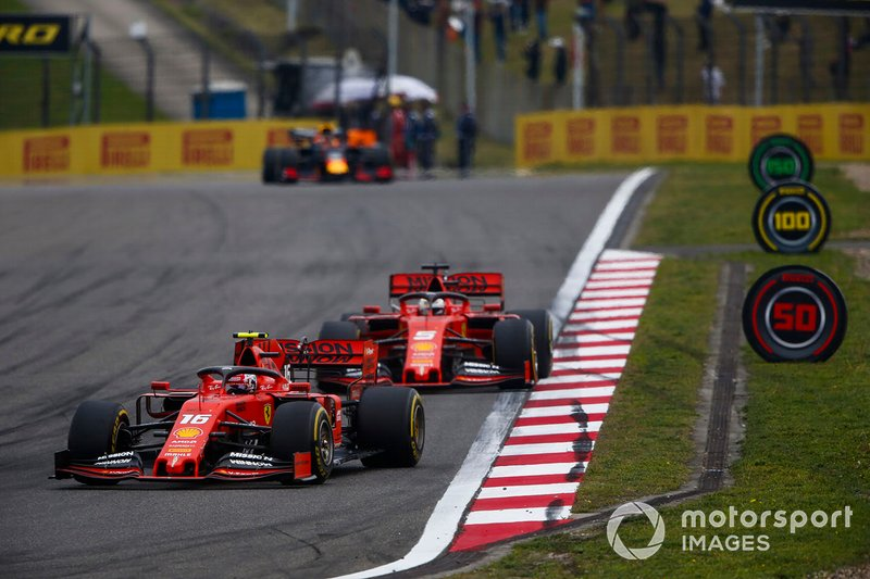 Charles Leclerc, Ferrari SF90, leads Sebastian Vettel, Ferrari SF90, and Max Verstappen, Red Bull Racing RB15