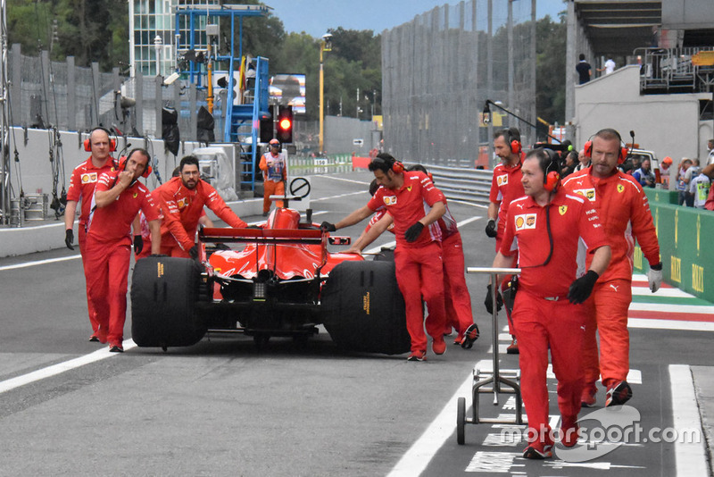 Sebastian Vettel pushed through pitlane