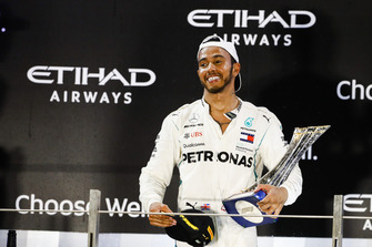 Lewis Hamilton, Mercedes AMG F1, 1st position, on the podium with his trophy