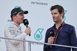 Nico Rosberg, Mercedes AMG F1 on the podium with Mark Webber, Porsche Team WEC Driver / Channel 4 Presenter