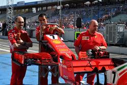 Ferrari mechanics with Ferrari SF71H nose and front wing