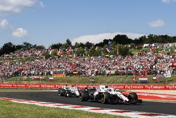 Sergey Sirotkin, Williams FW41, leads Charles Leclerc, Sauber C37