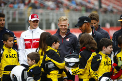 Young karters backed by the RACC, Spain's largest auto club, pose with Daniel Ricciardo, Red Bull Racing, Marcus Ericsson, Sauber, Kevin Magnussen, Haas F1 Team, Lewis Hamilton, Mercedes AMG F1, Romain Grosjean, Haas F1 Team, and Stoffel Vandoorne, McLaren