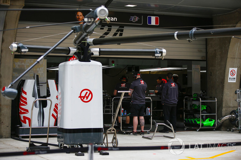 Haas bodywork in the pit lane outside of the team's garage